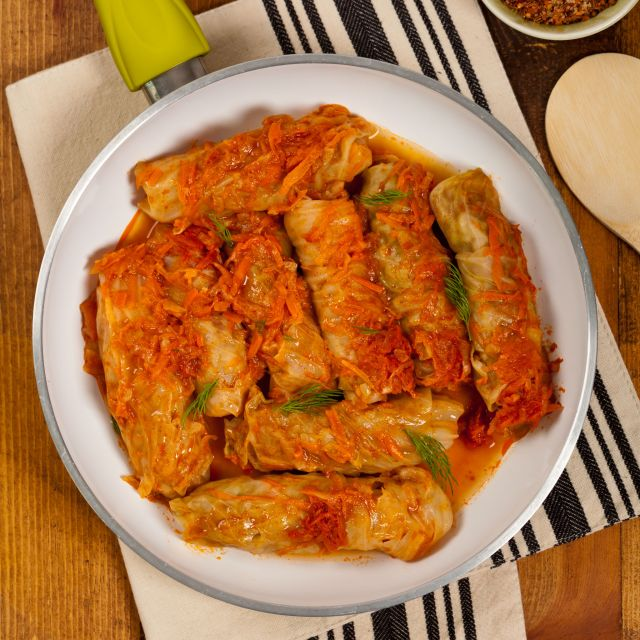 57769123 - stuffed cabbage with tomato sauce. selective focus.